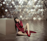 Conceptual photo of woman in the golden room Stock Photography