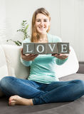 Conceptual photo of woman holding word Royalty Free Stock Photography
