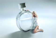 Conceptual photo of woman hugging the perfume Royalty Free Stock Photography