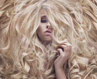 Conceptual photo of a women with lush wig. Conceptual photo of a woman with fluffy wig Royalty Free Stock Photo