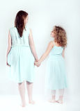Conceptual photo of young sisters stock photos