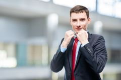 Conceptual photograph of a successful businessman ready. For battle  in office Royalty Free Stock Image