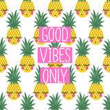 Conceptual phrase Good vibes only on seamless pattern with pineapples. Royalty Free Stock Image