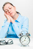 Conceptual picture of a asleep woman in the middle of a working. Day Royalty Free Stock Image