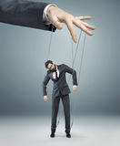 Conceptual picture of a boss pulling the strings Royalty Free Stock Images
