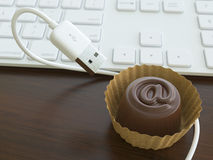 Conceptual Picture With Candy And USB Cable Stock Photo