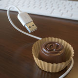 Conceptual Picture With Candy And USB Cable Royalty Free Stock Image