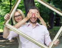 Conceptual picture of the couple holding a frame Stock Photo