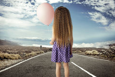 Conceptual picture of a girl with a ballon Royalty Free Stock Photo