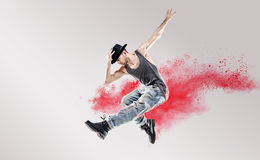 Conceptual picture of hip hop dancer among red dust Royalty Free Stock Images