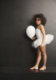 Conceptual picture of a little ballet dancer with a ballon Royalty Free Stock Photo