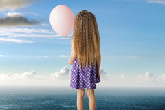 Conceptual picture of a little girl with a balloon Stock Photos