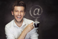 Conceptual picture of the man with coffee and the @ sign Stock Photos