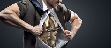 Conceptual picture of a man with golden chest Stock Photos