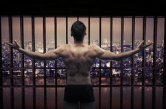 Conceptual picture of muscular guy looking at the city panorama Stock Photo