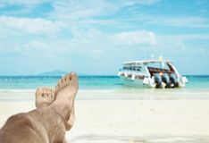 Conceptual picture of relaxing person on an asian beach Royalty Free Stock Photos