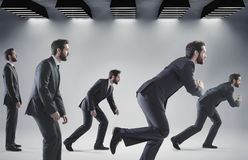 Conceptual picture of running businessmen Stock Image