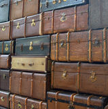 Conceptual picture of the wal of suitcases Stock Image