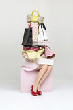 Conceptual picture of a woman holding plenty of handbags Royalty Free Stock Photography