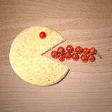 Conceptual pizza smile eat tomatoes Stock Images