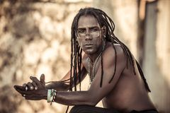Black man with dreadlocks, glasses, Topless, serious. Conceptual portrait of black man with dreadlocks Royalty Free Stock Image