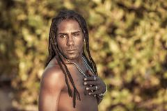 Black man with dreadlocks thinks about life. Conceptual portrait of black man with dreadlocks Royalty Free Stock Image