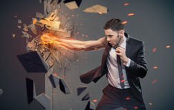 Conceptual portrait of a businessman beating a barrier Stock Image
