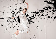 Conceptual portrait of a jumping painter Royalty Free Stock Images