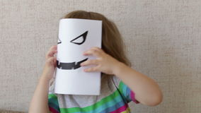 Conceptual portrait. Little child wearing a halloween mask stock footage