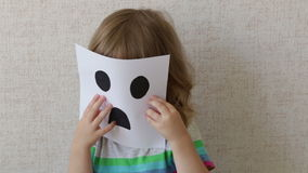 Conceptual portrait. Little child wearing a mask. Smiley. stock footage
