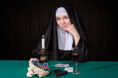 Conceptual portrait of a nun and gambling Royalty Free Stock Images