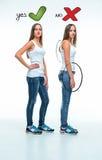 Conceptual portrait of two beautiful twin young women Stock Photo