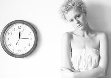 Conceptual portrait of woman with big clock Royalty Free Stock Photos