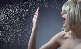 Conceptual portrait of woman blocking a water drops Royalty Free Stock Images