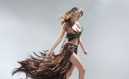 Conceptual portriat of the woman wearing dress made of hair. Conceptual portriat of the woman wearing gown made of hair Royalty Free Stock Photo