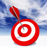 Conceptual red dart target board with arrow in the center on clouds Stock Photos