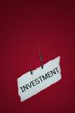 Conceptual, riesgo de inversión en el anzuelo. Foto de archivo libre de regalías