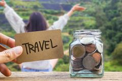Conceptual saving money for travel with blurred happy time vacat. Ion as background stock images