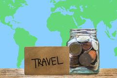 Conceptual saving money for travel with world map as background. Conceptual saving money for travel with world map as background Stock Image