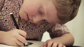 Conceptual scene: boy searchs life questions answers writing QUESTION MARKs. 