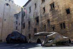 Conceptual sculptures at Palais des Papes (Papal palace) in Avignon France. AVIGNON FRANCE - JUNE 18 2018: Conceptual sculptures at Palais des Papes (Papal royalty free stock photo