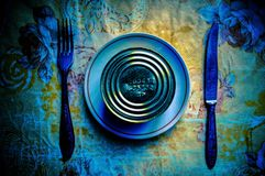 Conceptual serving of breakfast from canned food, knife and forks. royalty free stock photo