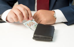 Conceptual shot of businessman taking money from the wallet Stock Photos