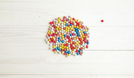 Conceptual shot of colorful ball apart of group of balls on whit Stock Photo