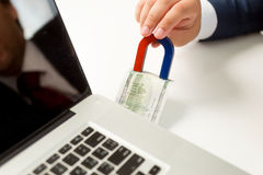 Conceptual shot of stealing money in internet Royalty Free Stock Photography