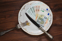 Conceptual still life with money on the plate. Some money of different countries shooted like a meal stock photos