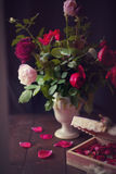 Conceptual Still Life Roses in a Vintage Vase Stock Photos