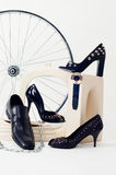 Conceptual still-life with shoes and wheel Stock Photo