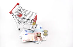 Conceptual studio shot of a bunch of euro banknotes filling a shopping cart on white background september 18, 2016 Stock Images