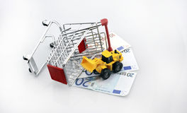 Conceptual studio shot of a bunch of euro banknotes filling a shopping cart on white background september 18, 2016 Royalty Free Stock Image